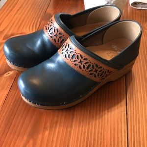 Dansko Leather blue clogs with camel trim detail